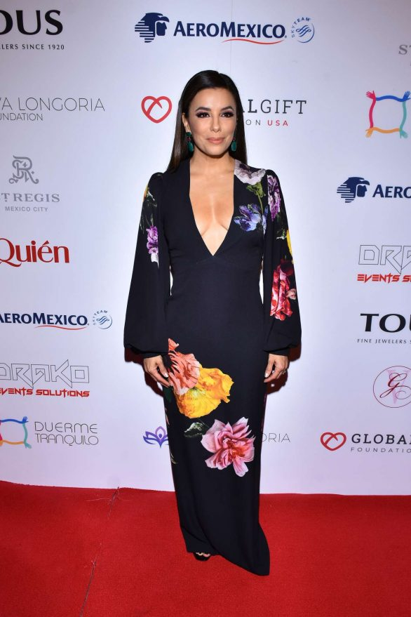 Eva Longoria commands attention in a deeply plunging black floral dress as she attends the 5th Global Gift Foundation USA in Mexico