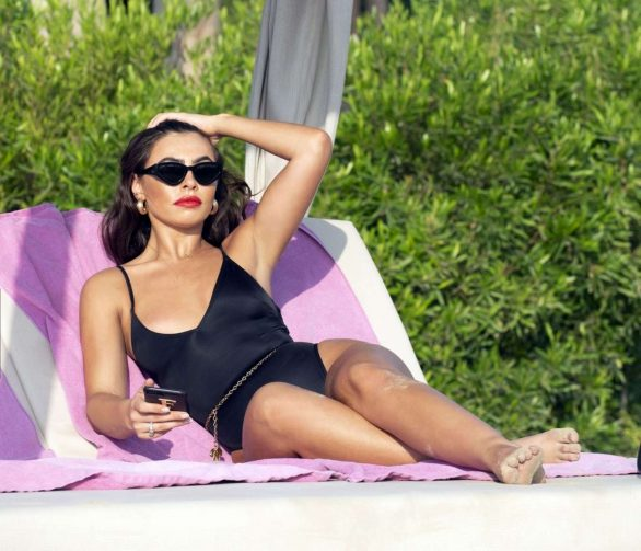 Francesca Allen wears a black swimsuit as she soaks up the sun at the beach while on holiday in Dubai, UAE