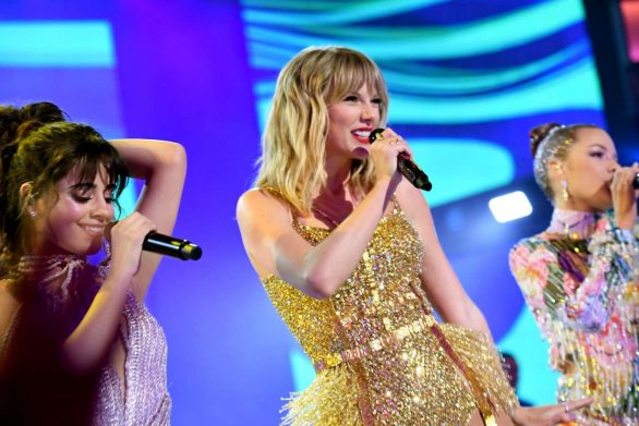 Taylor Swift performs medley of hits ahead of snagging both artist of the year and decade awards at AMAs