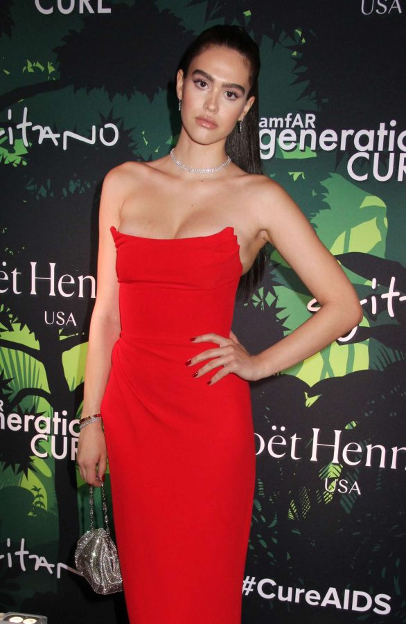 Delilah Belle Hamlin and sister Amelia attend star-studded amfAR generationCURE Holiday Party