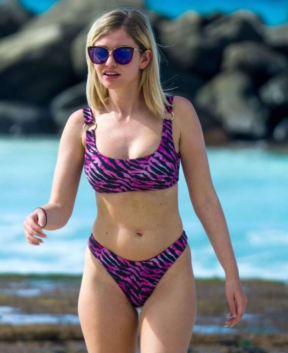 Love Island's Amy Hart commands attention in a purple animal print bikini as she soaks up the sun on idyllic getaway in Barbados