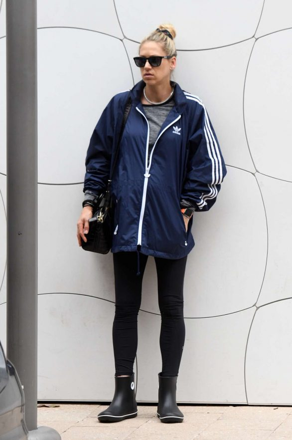 Anna Kournikova cuts a relaxed figure as she awaits her car in a tracksuit and chunky boots in Miami