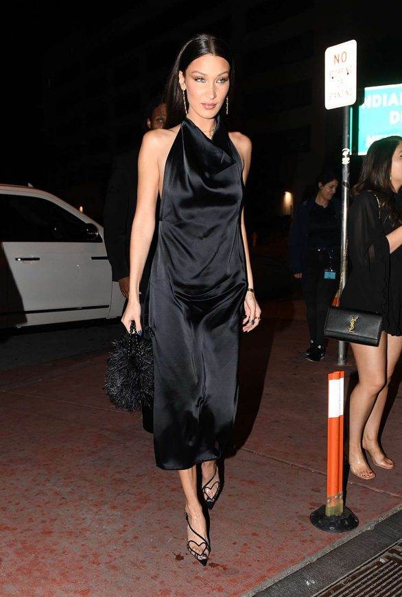 Bella Hadid Pics in High Slit Silky Black Dress Arriving to a celebrity filled dinner during Art Basel in Miami