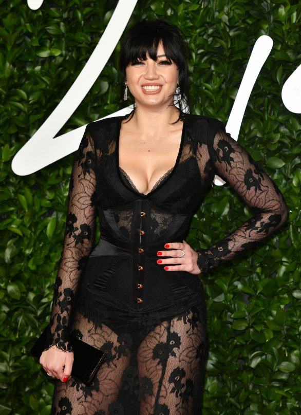 British Fashion Awards 2019: Daisy Lowe puts on a VERY busty display as she flaunts her hourglass curves in a sheer lace dress with a sexy corset