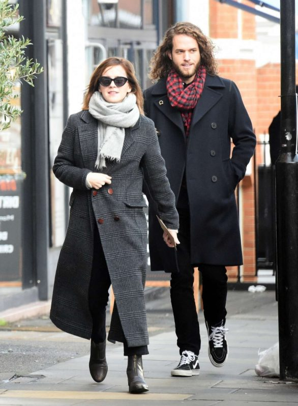 Emma Watson looks very happy while out on a lunch date with her mystery boyfriend in London, UK