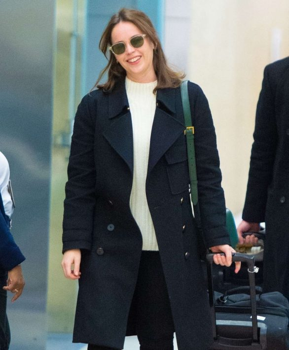 Felicity Jones and husband Charles Guard are all smiles as they touch down at JFK Airport in New York City