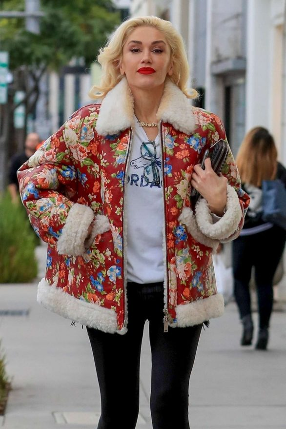 Gwen Stefani dons patterned shearling coat and white cowboy boots while shopping in Beverly Hills
