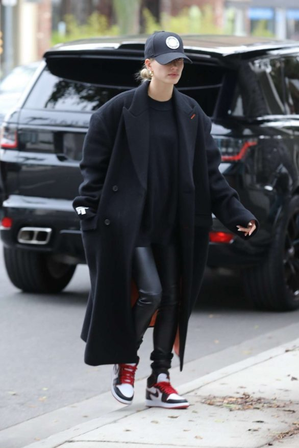 Hailey Bieber is engulfed in a large overcoat as she drops by the salon for some styling... after returning from sunny Miami