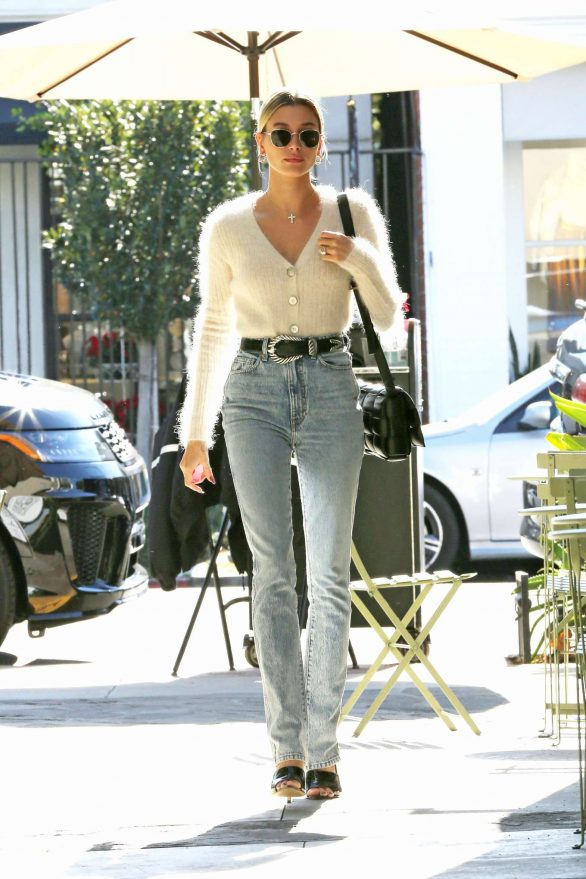 Hailey Bieber gets fresh look for holidays as she emerges from salon with golden blonde hair down