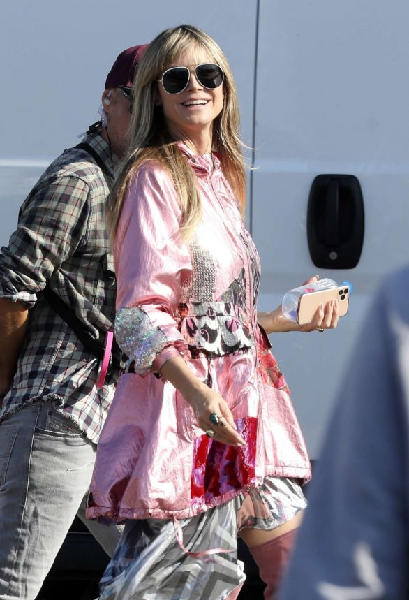 Heidi Klum flashes a peace sign in head-to-toe pink as she films Germany's Next Top Model in LA