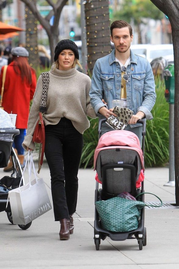 Hilary Duff goes Beverly Hills holiday shopping with fiance Matthew Koma as he pushes baby Banks in stroller