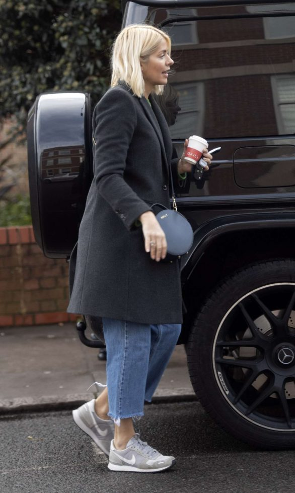 Holly Willoughby keeps casual in jeans, trainers and a wool coat as she grabs a coffee while enjoying her long Christmas break from This Morning