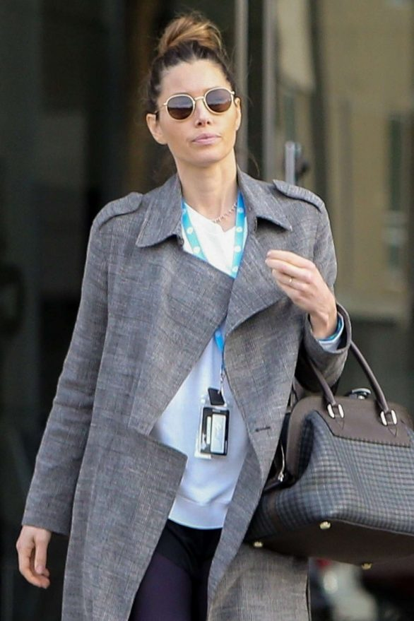 Jessica Biel flashes her wedding band while mixing an elegant overcoat with casual leggings during an LA outing
