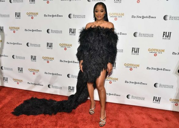 Keke Palmer flaunts her toned legs in a fabulous feathered frock as she attends the Gotham Awards