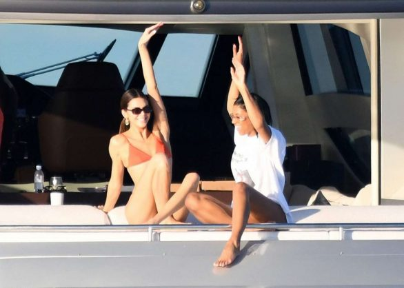 Kendall Jenner is a bikini-clad bookworm as she pours through essays on young love while relaxing on David Grutman's yacht