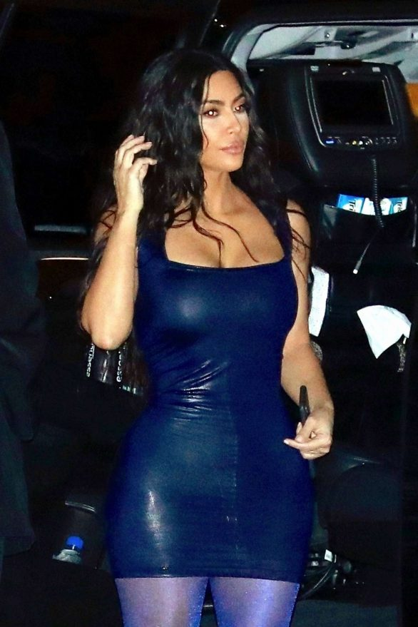 Kim Kardashian displays her famous curves in eye-popping mini with purple tights and racy metallic boots at KKW Beauty/Kylie Cosmetics Christmas bash