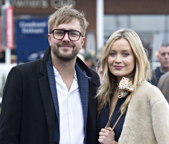 Laura Whitmore looks effortlessly chic in a furry cream jacket and floral navy dress as she joins beau Iain Stirling at the Ladbrokes Winter Carnival
