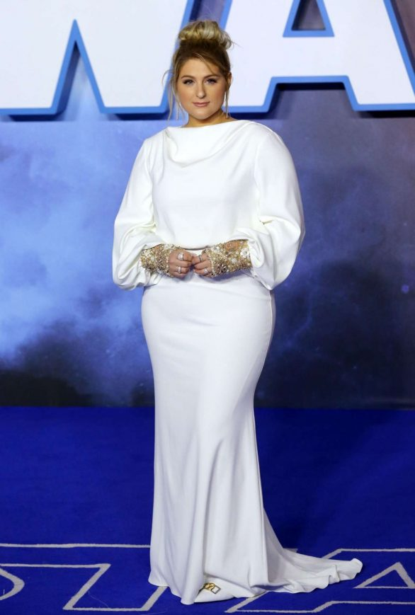 Meghan Trainor exudes glamour in a white gown as she packs on the PDA with husband Daryl Sabara at Star Wars: The Rise Of Skywalker premiere