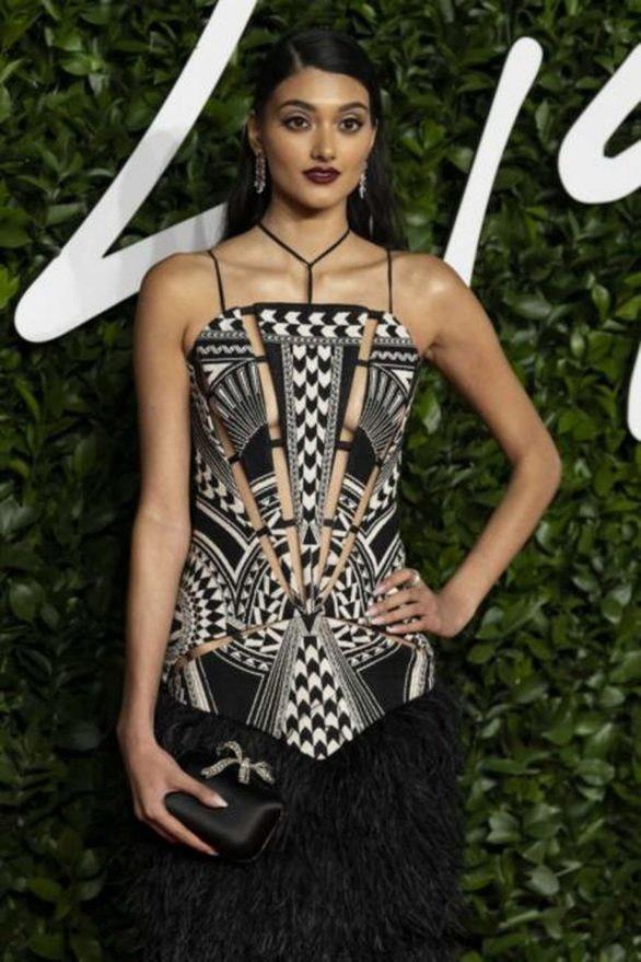 Neelam Gill puts on a jaw-dropping display in a deeply plunging pinstripe jumpsuit at Fenty British Fashion Awards after-party