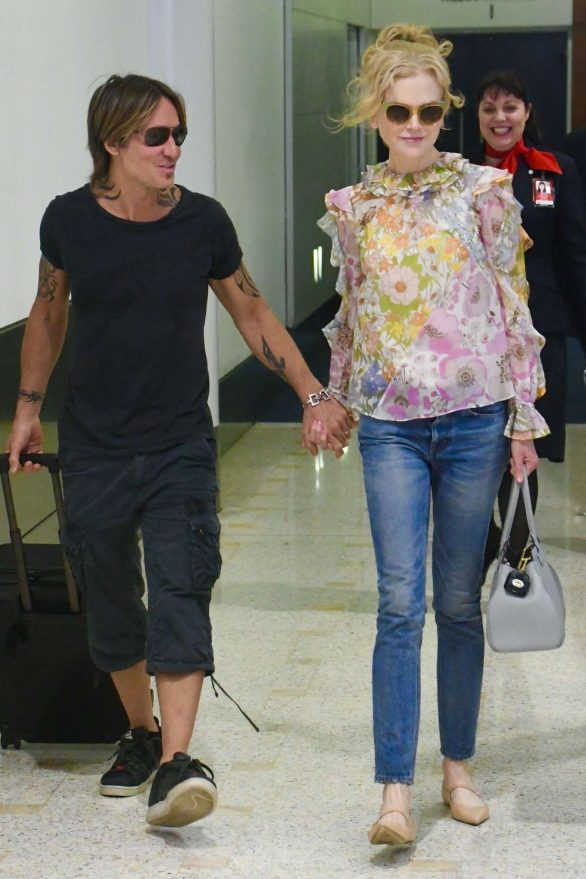 Nicole Kidman looks glamorous as she's reunited at Sydney Airport with Keith Urban ahead of Christmas festivities Down Under