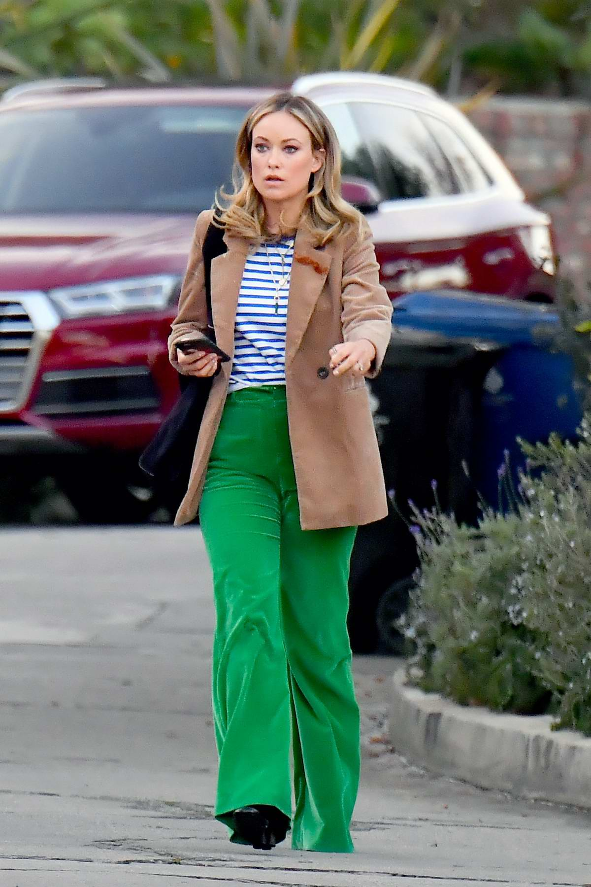 Olivia Wilde looks great in bright green pants and brown blazer as she heads to dinner in Los Angeles