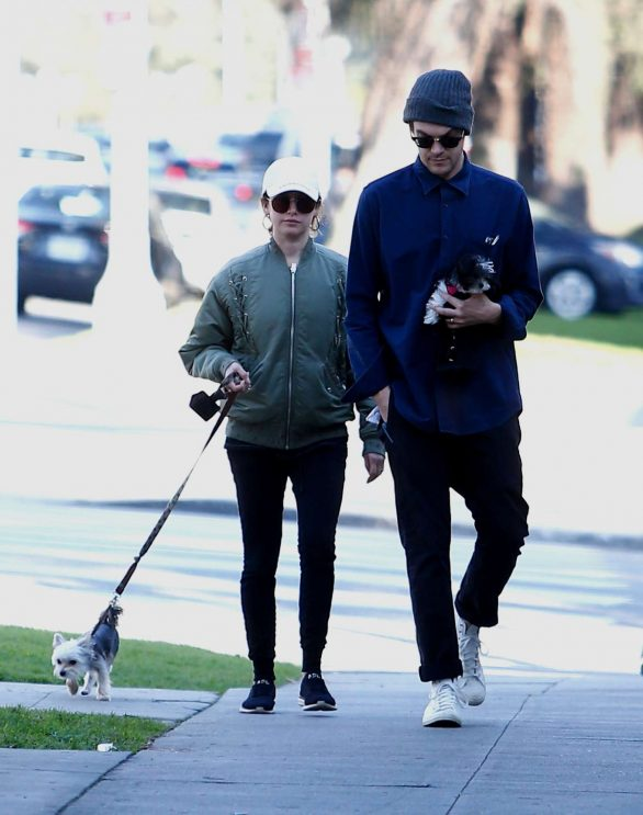 Ashley Tisdale and husband Christopher French walk their pups as they enjoy the holiday weekend