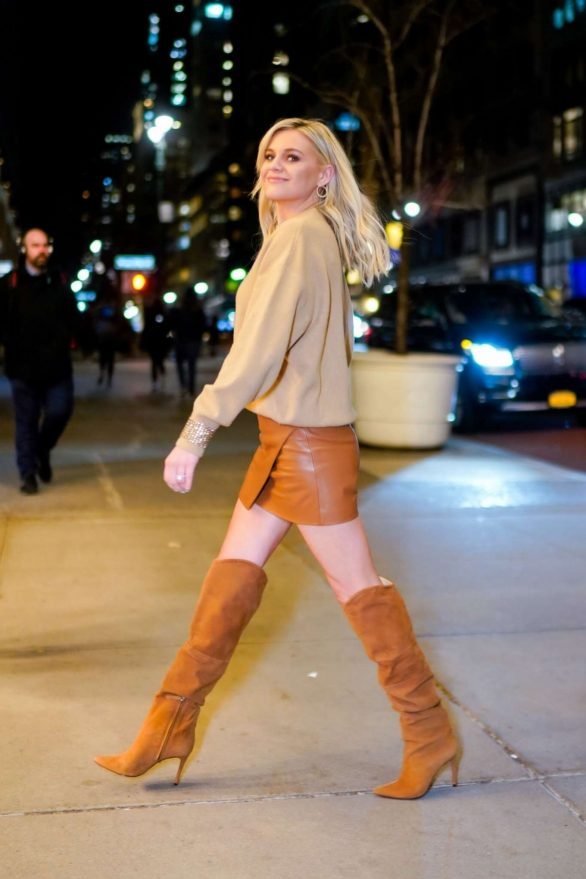 Kelsea Ballerini turns heads in leather mini skirt and high-heeled boots as she steps out in NYC