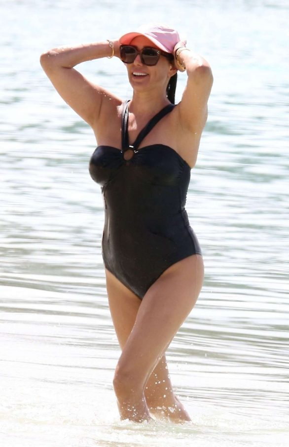Lauren Silverman Pics in Black Swimsuit on the beach in Barbados