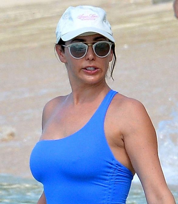 Lauren Silverman Pics in Blue Swimsuit at a beach in Barbados