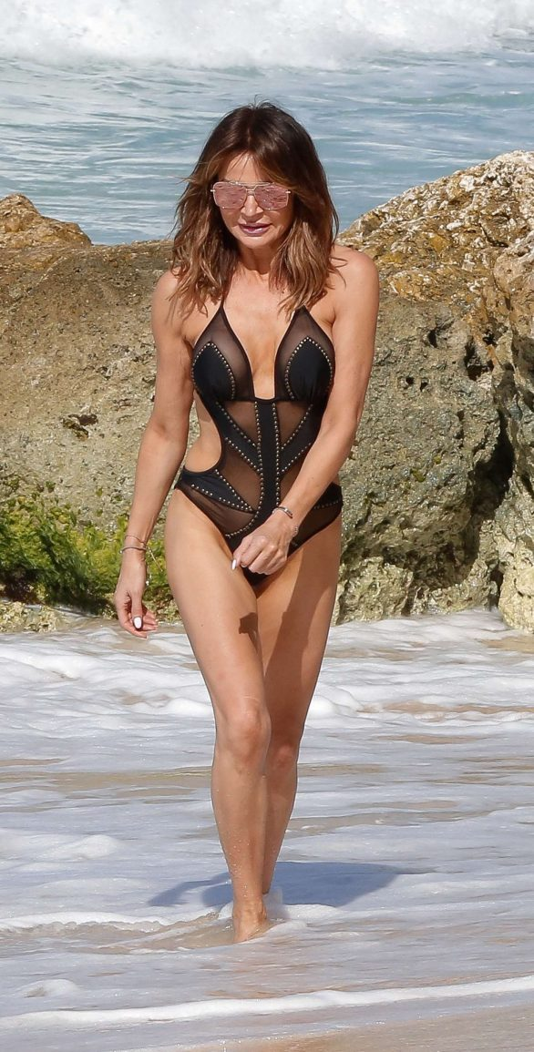 Lizzie Cundy Pics In black swimsuit on the beach Barbados