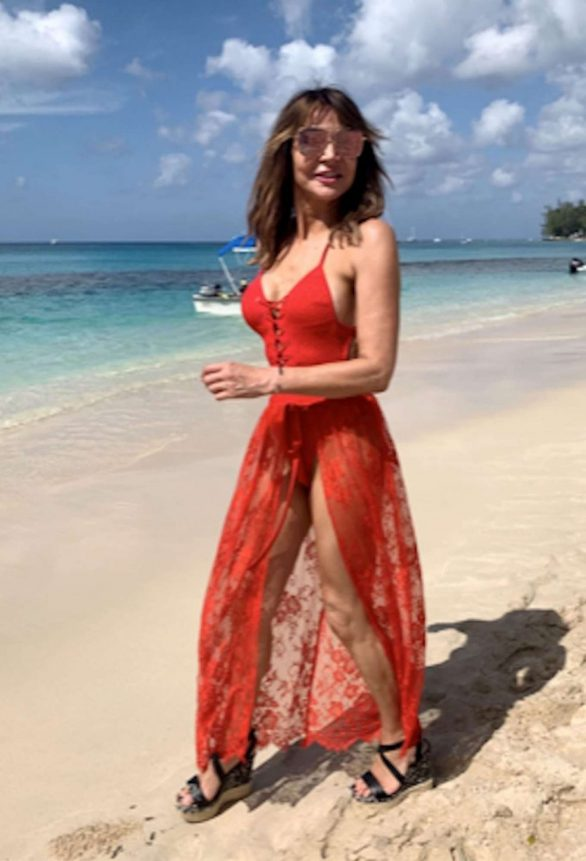 Lizzie Cundy Pics in Red Swimsuit on the beach in Barbados