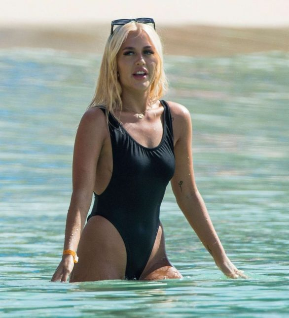 Lottie Tomlinson Pics in Black Swimsuit on the beach in Barbados