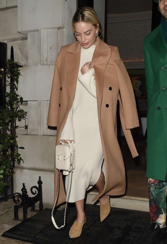 Margot Robbie showcases her chic sense of style in understated look as she enjoys a night out in London ahead of the Oscars