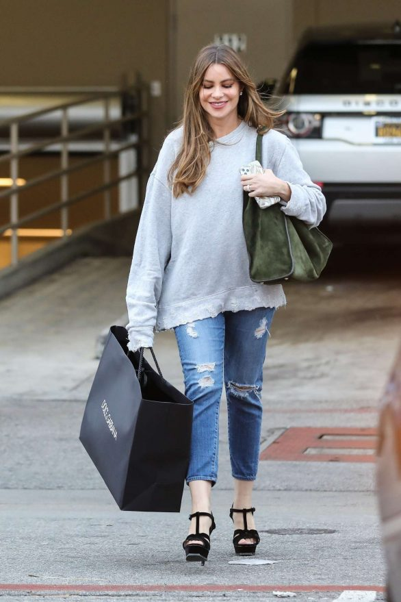 Sofia Vergara sports a casual look in a ragged gray sweatshirt after shopping at Dolce & Gabbana