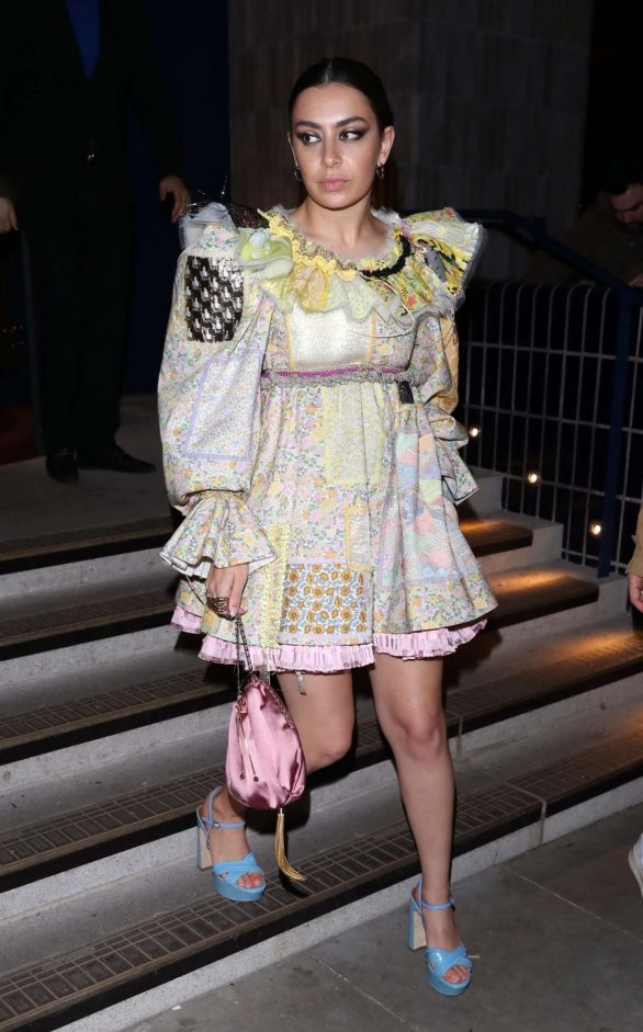 Charli XCX steps out in a ruffled patch work mini dress for LOVE magazine LFW party