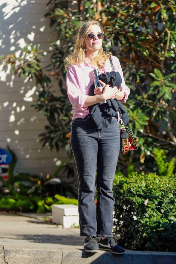 Rachel McAdams dons jeans and pink dress shirt while out taking care of errands in Los Angeles