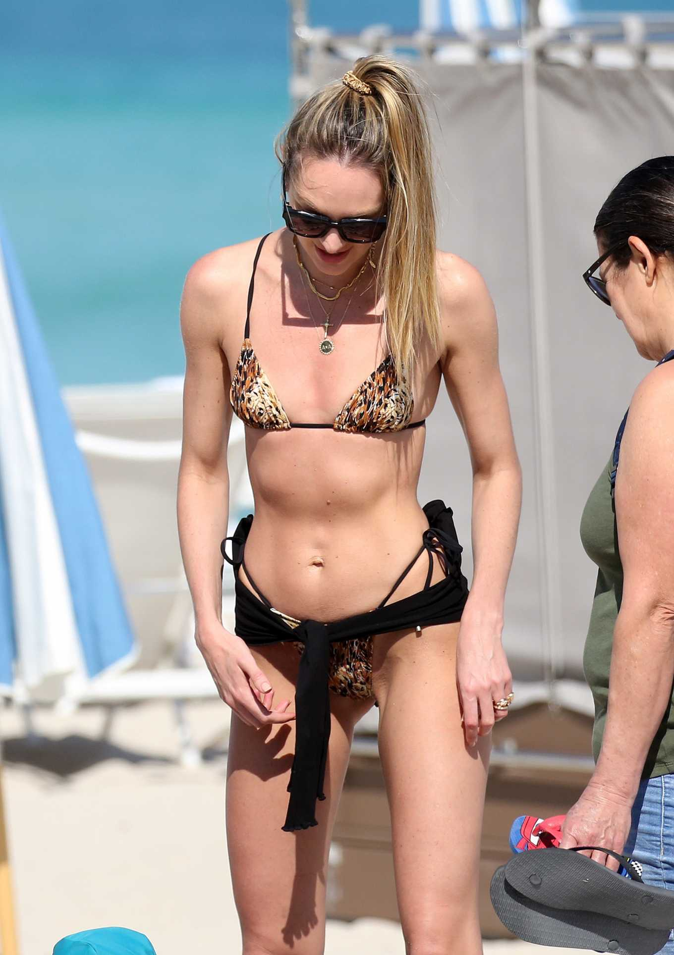 Candice Swanepoel Pics in Animal Print Bikini on the beach in Miami