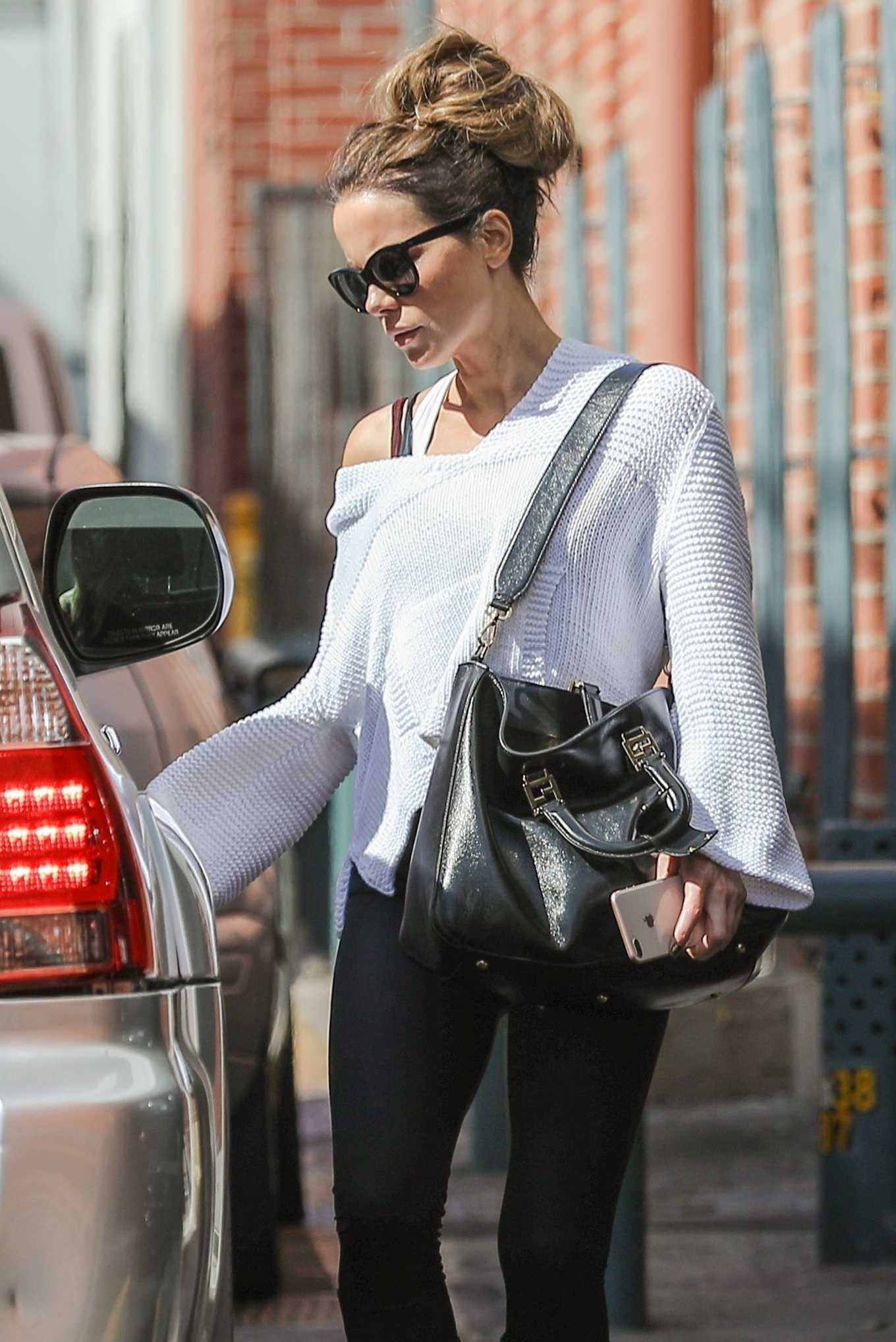 Kate Beckinsale in Black Leggings While Exit a medical building in Los Angeles