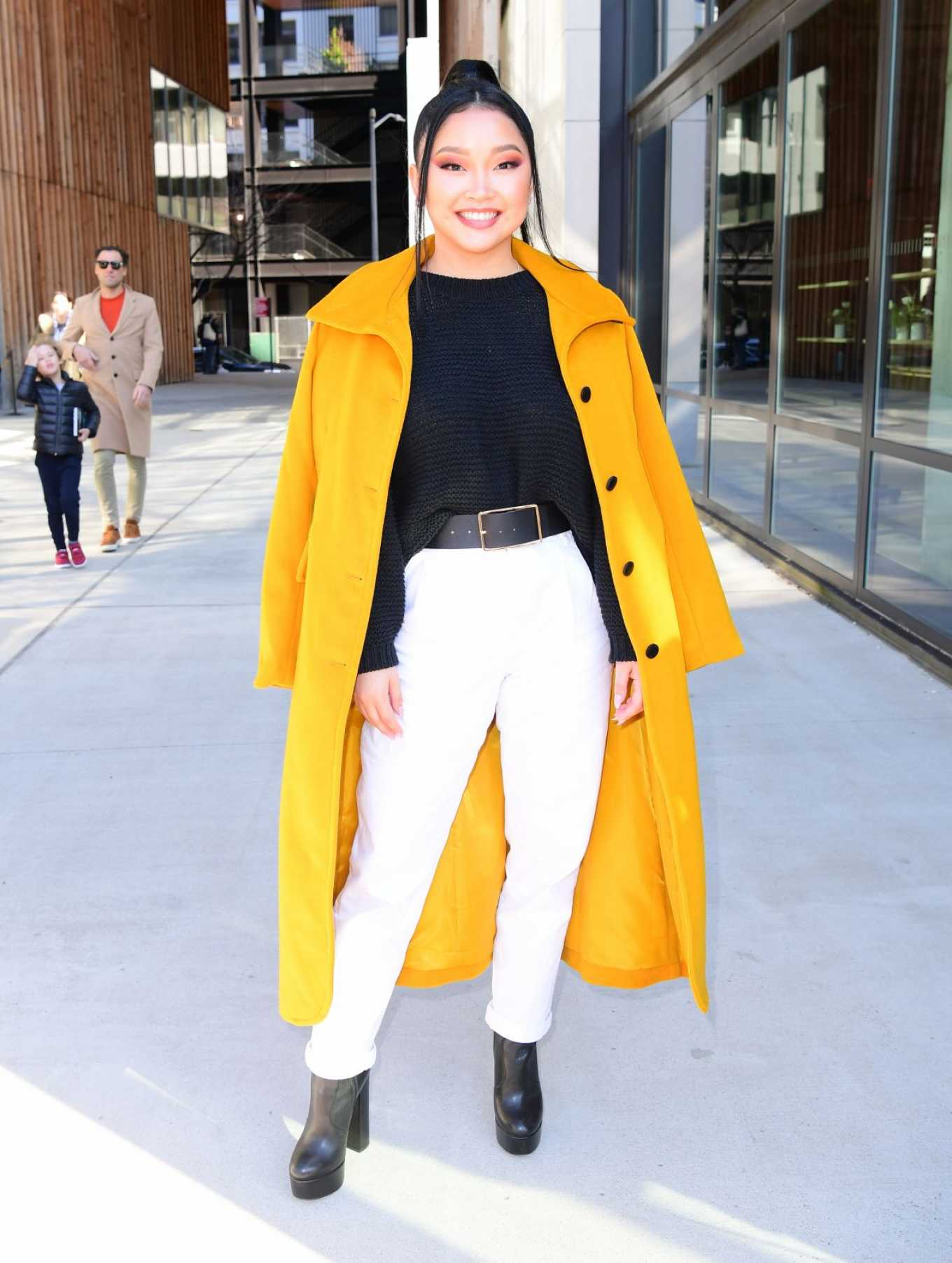 Lana Condor In a yellow coat posing while out in NYC