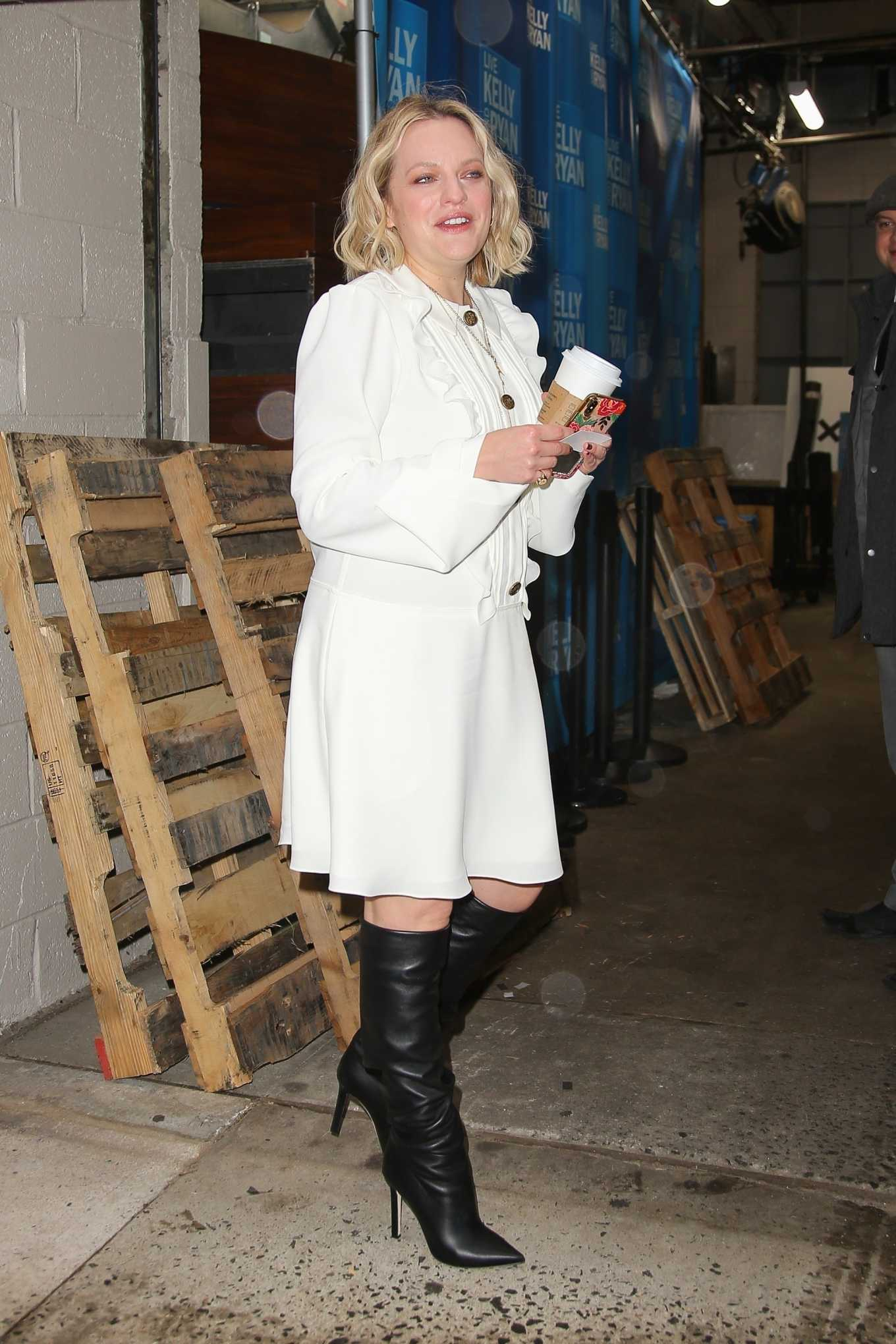 Elisabeth Moss In A White Dress And Black Boots