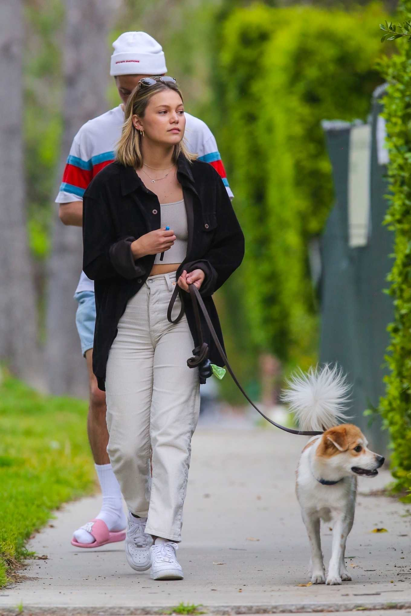 Olivia Holt – Walks her dog with a mystery friend in Los Angeles-03